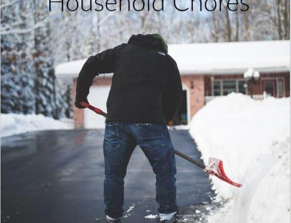 man shoveling snow off a driveway