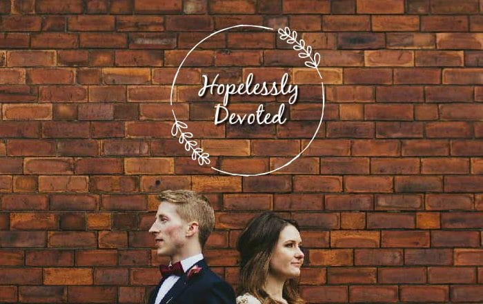 Couple against brick wall - Hopelessly Devoted