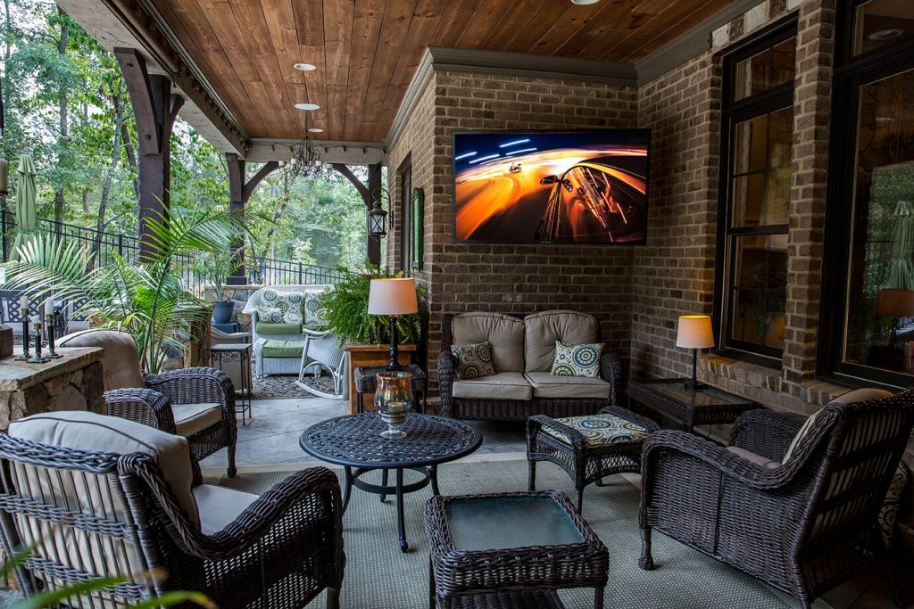 Outdoor Living Space on a porch with an all weather SunBriteTV Veranda Series TV