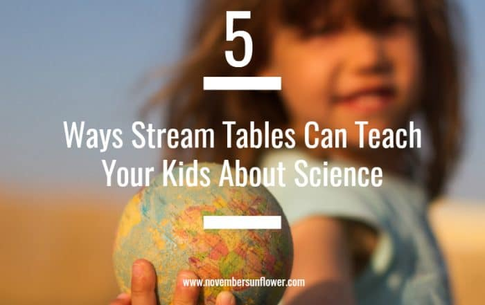 young girl holding a globe - 5 ways stream tables can teach your kids about science